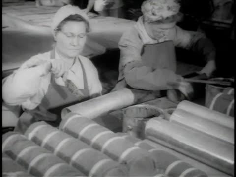 November 1942 WS Women working brushing long tubes / Long Beach, California, United States