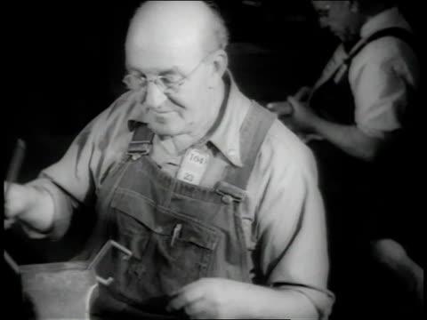 November 1942 HA worker filing parts at bench / Long Beach, California, United States