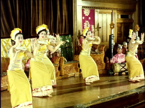 november 1964 balinese dancers performing traditional dances while music is played on a gamelan / bali, indonesia - 1964 stock videos and b-roll footage