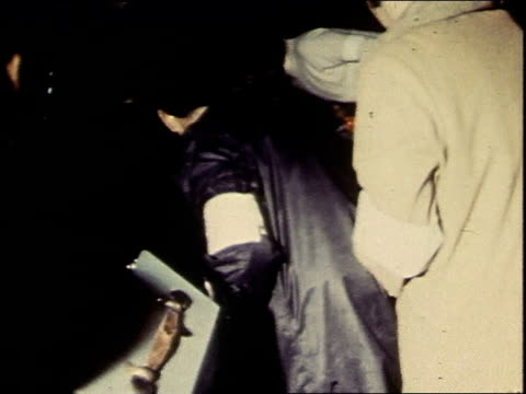 vidéos et rushes de november 1969 montage crowd gathered around someone being put into an ambulance / washington, d.c., united states - 1969