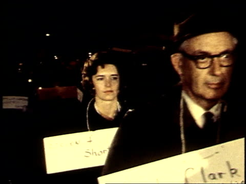 november 1969 ms procession of protesters at candlelight vigil holding placards bearing names of soldiers killed in combat / washington dc united... - candlelight stock videos & royalty-free footage