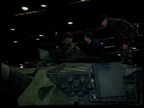 november 1997 yugoslavia: bosnia: banja luka: tony blair mp inspecting tank with members of king's royal hussars during visit to bosnia blair eating... - banja luka stock videos & royalty-free footage
