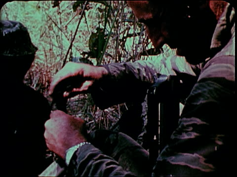 november 2 1967 montage soldiers cleaning m16 / south vietnam - gewehr stock-videos und b-roll-filmmaterial