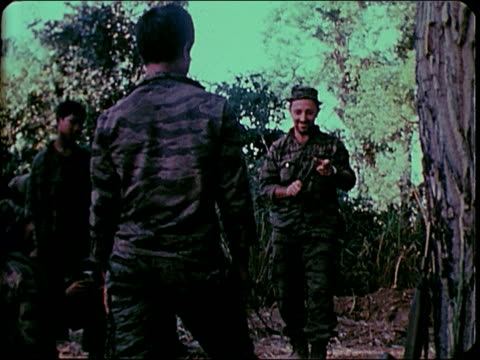 november 2 1967 montage soldiers practicing knife throwing / south vietnam - south vietnam stock videos and b-roll footage