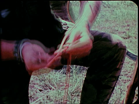 november 2, 1967 montage soldiers wiring detonator / south vietnam - 起爆装置点の映像素材/bロール