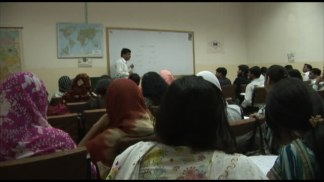 november 2 2005 tu university students in classroom with teacher speaking / lahore pakistan  - ceiling fan stock videos & royalty-free footage