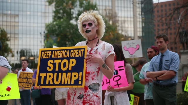 november 2 2016 indianapolis indiana usa a transgendered women's rights activist covered in fake blood holds a sign reading keep america great stop... - menstruation stock videos & royalty-free footage