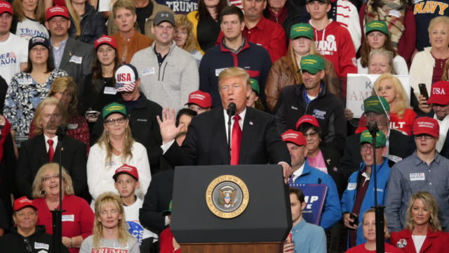 A Trump supporter dabs as president Trump speaks about an early phone call from former Indiana University basketball coach Bob Knight during a...