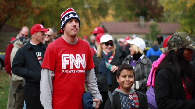 trump supporter wears a shirt reading fake news network in reference to cnn while waiting in line before president trump arrives to speak during a... - reading stock videos & royalty-free footage