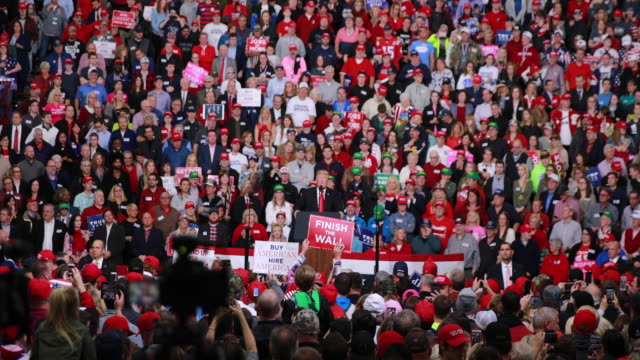 trump supporters listen as president trump speaks during a political rally at southport high school in southport indiana trump was in indiana... - midterm election stock videos & royalty-free footage