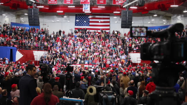 trump supporters listen as president trump speaks during a political rally at southport high school in southport indiana trump was in indiana... - unterstützer stock-videos und b-roll-filmmaterial