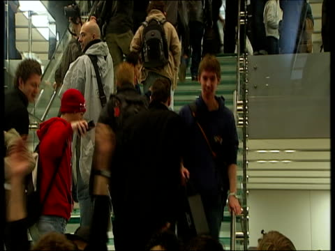 november 2007 montage shoppers walking down stairs and holding new apple iphone aloft for applauding crowd past others in queue/ london uk/ england/... - 2007 stock videos & royalty-free footage