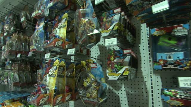 stockvideo's en b-roll-footage met november 24 2009 ds toys r us display rack with toys in plastic packaging / united states - speelgoed