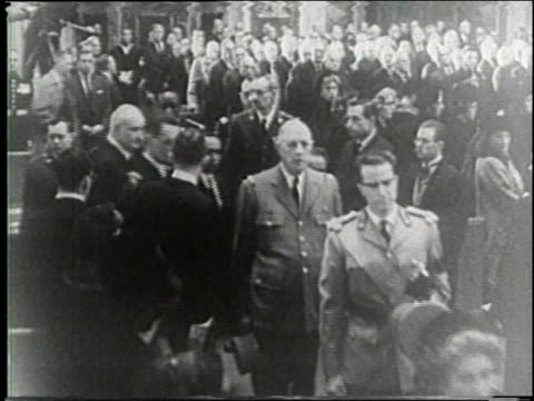 november 25 1963 ha french president charles de gaulle west german president heinrich lubke along with other heads of state move up the aisle at the... - charles de gaulle stock videos & royalty-free footage