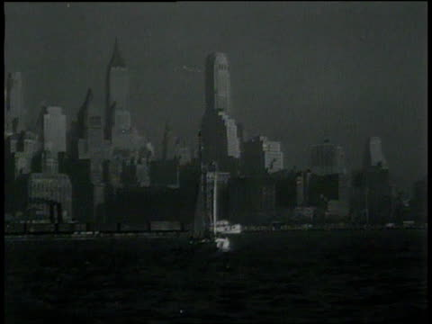 november 26, 1931 montage boats sailing in harbor with new york city skyline in background / united states - 1931 stock videos & royalty-free footage