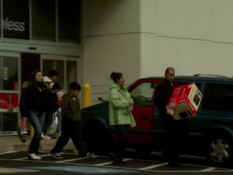 november 27, 2008 shoppers leaving circuit city electronics store with their purchase / united states - 2008 stock videos & royalty-free footage