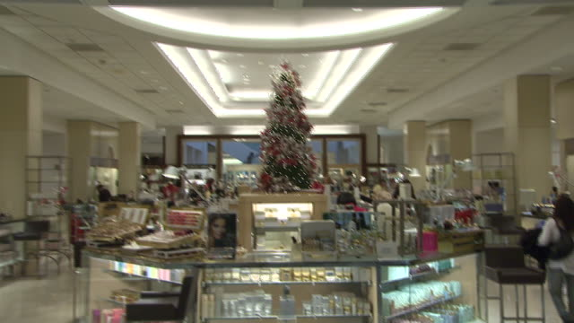 november 27 2009 td customers shopping and employees working in a neiman marcus decorated for the holidays / united states - neiman marcus stock videos & royalty-free footage
