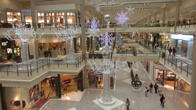 november 27 2009 zo customers shopping in a threestory neiman marcus decorated for the holidays / united states - neiman marcus stock videos & royalty-free footage