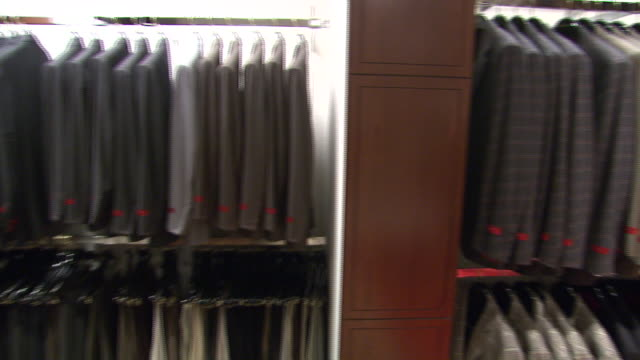november 27 2009 pan men's suits on display in neiman marcus / united states - neiman marcus stock videos & royalty-free footage