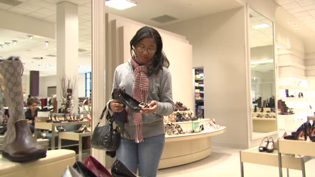 november 27 2009 ts patron browsing in the neiman marcus shoe department / united states - neiman marcus stock videos & royalty-free footage