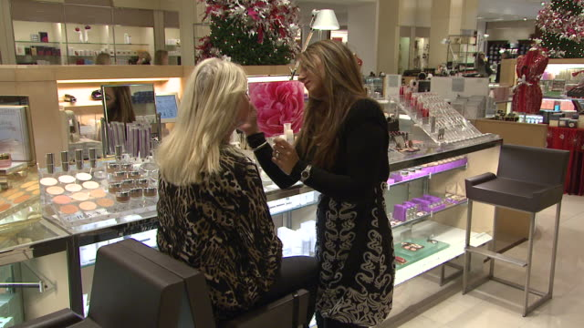 november 27 2009 zo patron getting beauty tips at neiman marcus makeup counter / united states - neiman marcus stock videos & royalty-free footage