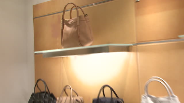 november 27 2009 ts purses on display in the neiman marcus shoe department / united states - neiman marcus stock videos & royalty-free footage