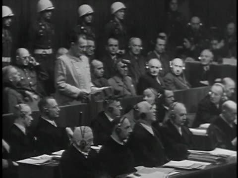 november 29 1945 b/w hermann goering speaking in german on behalf of nazi defendants man translating for court / nuremberg germany - processi di norimberga video stock e b–roll