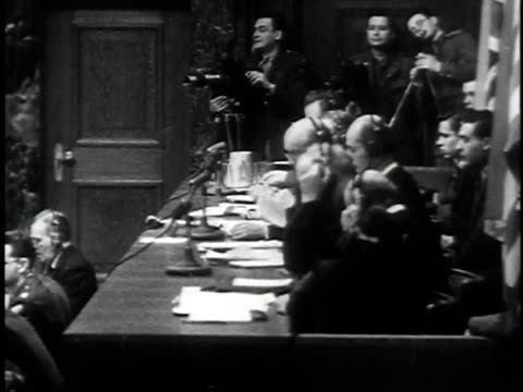 november 29 1945 montage judges ordering the defendants will plead guilty or not guilty / nuremberg germany - processi di norimberga video stock e b–roll