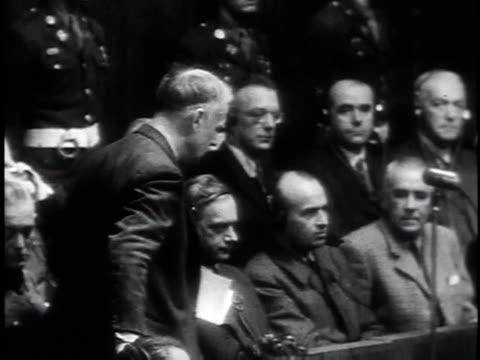 november 29 1945 montage nazis plead not guilty rudolph hess joachim von ribbentrop julius streicher / nuremberg germany - processi di norimberga video stock e b–roll