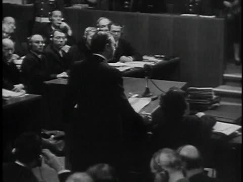 november 29 1945 montage prosecutor robert jackson giving opening statement during prosecution of nazis / nuremberg germany - processi di norimberga video stock e b–roll