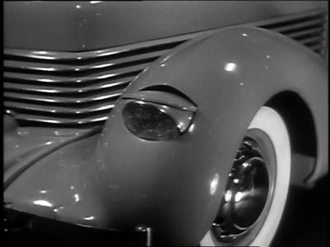 November 4, 1935 MONTAGE Woman demonstrating several car features including flip up headlights / New York, New York, United States