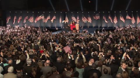 november 4, 2008 crowd in grant park cheering as barack obama takes the stage with wife michelle and daughters malia and sasha after winning the... - 2008 bildbanksvideor och videomaterial från bakom kulisserna