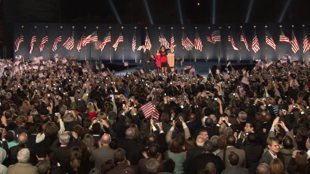 November 4 2008 WS Crowd in Grant Park cheering as Barack Obama takes the stage with wife Michelle and daughters Malia and Sasha after winning the...