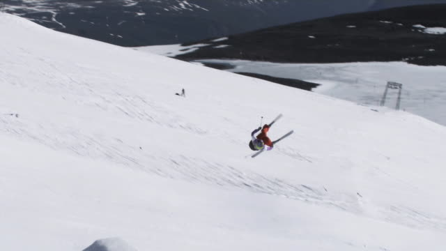 november 5, 2009 a professional skier successfully completing an extreme rotational jump over a gap - stunt stock-videos und b-roll-filmmaterial