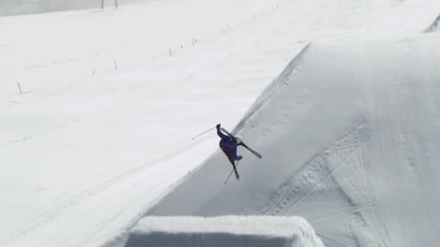 november 5, 2009 a professional skier successfully completing an extreme rotational jump - freistil skifahren stock-videos und b-roll-filmmaterial