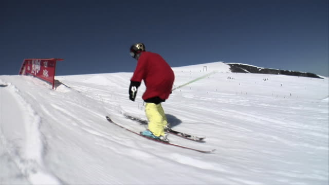 november 5 2009 ts two professional freestyle skiers completing extreme maneuvers on obstacles - corkscrew stock videos & royalty-free footage