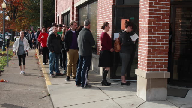 november 5 bloomington indiana early voters wait in line at the monroe county voting center to cast their ballots in bloomington indiana during the... - midterm election stock videos & royalty-free footage