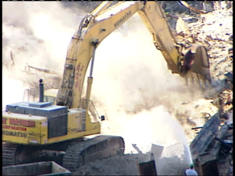 november 6, 2001 excavator digging in rubble at ground zero stirring up smoke and ash / new york city, new york, united states - rubble stock-videos und b-roll-filmmaterial