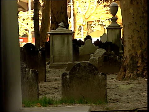 november 6, 2001 montage an historic cemetery with empty park benches near the graves and old-fashioned headstones / new york city, new york, united... - cemetery stock videos & royalty-free footage