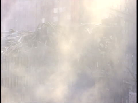 November 6 2001 MONTAGE World Trade Center Ground Zero devastation with cleanup underway and firemen hosing down the dust and debris / New York City...