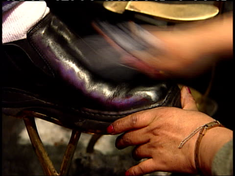 november 6 2001 zi shoeshiner polishing black dress shoes for patron / new york city new york united states - dress shoe stock videos and b-roll footage