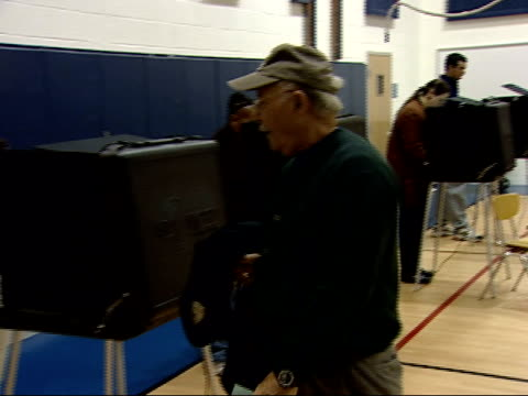 November 7 2006 TS Voter walking across gym to voting booth / Virginia United States