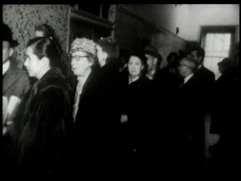 vídeos de stock e filmes b-roll de november 8 1960 montage line of people forms to vote in presidential election as electronic ticker updates results - 1960