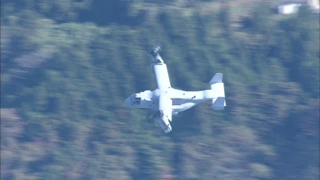 november 8 2014 aerial shot of a flying american military aircraft mv22 called osprey incoming to kesennuma oshima island in miyagi to join the... - notfallübung stock-videos und b-roll-filmmaterial