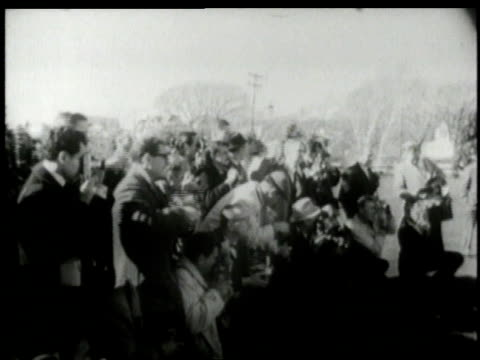 stockvideo's en b-roll-footage met november 9 1960 montage john f kennedy poses for photos with jacqueline kennedy and their child / washington dc united states - jacqueline kennedy