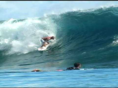 november 9, 2009 professional surfer dropping in and riding out a wave front side through the curtain of the barrel - letterbox format stock videos & royalty-free footage
