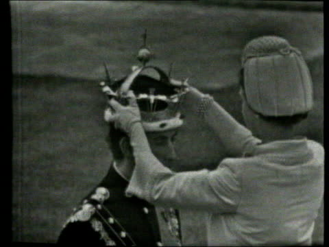 november; in 1948 prince charles, the prince of wales was born b/w lib wales: caernarvon: ext prince of wales at investiture ends lib guyana: charles... - チャールズ皇太子点の映像素材/bロール