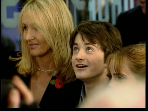 november; in 2001 the premiere of harry potter film took place lib england: london: ext stars of film photocall with author j.k.rowling / ross kemp... - fototermin stock-videos und b-roll-filmmaterial
