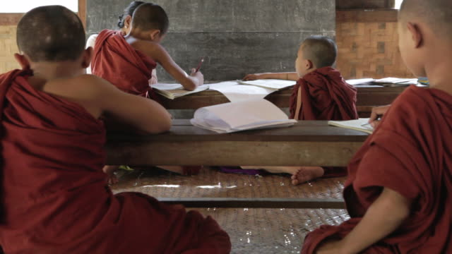 MS Novice Buddhist monks study in a classroom / Bagan, Myanmar