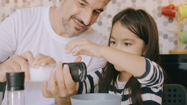 vídeos de stock e filmes b-roll de now put some salt into it. - domestic kitchen